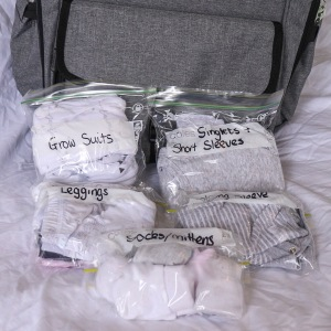 packing hospital bag baby items in ziplock bags